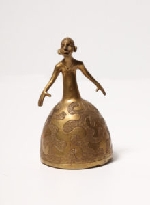 Brass bell of woman in skirt with Nigerian pattern, Artist Unknown, n.d.