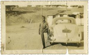 Photograph of soldier against a car, undatedAsh Family Photographs