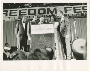 Dr. Martin Luther King Jr. and others sing at the Chicago Freedom Festival to End Slums and Segregation