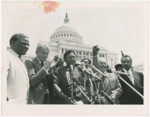 Dr. Joseph Echols Lowery speaking at podium on the steps of the United States Cpaital