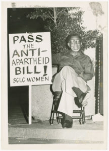 Dr. Joseph Echols Lowery holding a sign